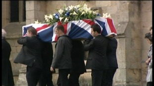 Coffin arriving at church