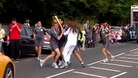 Security guards surround the Olympic Torch