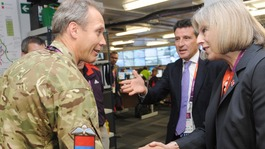 Theresa May meets Colonel Gary Wilkinson as she views the Olympics security control room in the Olympic park