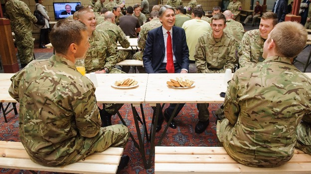 Defence Secretary Philip Hammond speaks to troops during a visit to the temporary Army barracks in east London