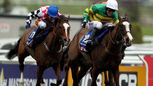 Tony McCoy rides to victory in the Cheltenham Gold Cup on Synchronised