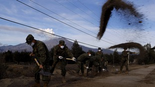 Soldiers remove ash that fell from Calbuco Volcano