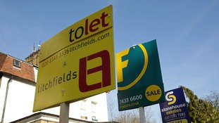 Close-up shot of estate agent signs