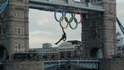 Royal Marine Martin Williams abseiling from a helicopter with the Olympic flame into the grounds of the Tower of London
