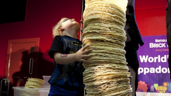 Mia Mason aged 4 helps the chefs of Poppadom Restaurant attempt to break the Guinness World Record