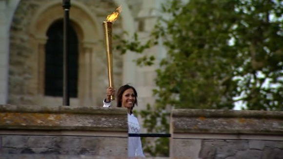 Dame Kelly Homes at Tower of London with Olympic torch