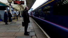 Adrian waits to board the London Paddington train service from Cardiff Central station