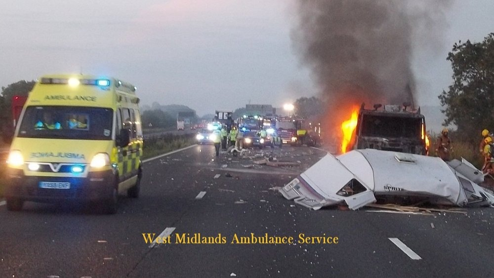 Picture of crash between lorry and car towing caravan ...
