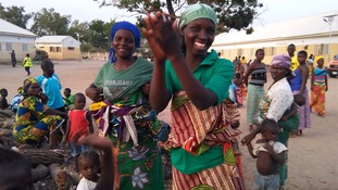 Women displaced by Boko Haram violence welcome the new arrivals.