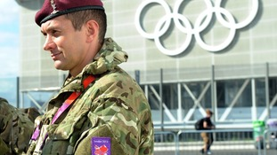 British Army personnel patrol the Olympic Park in Stratford, as preparations continue for the London 2012 Olympics.