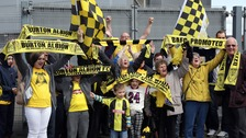 Fans show their support ahead of the clubs trophy presentation.