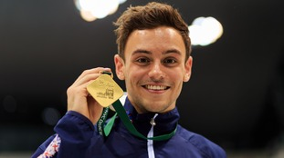Tom Daley holds his gold medal after winning the men's 10m platform final during the FINA Diving World Series at London Aquatics Centre.