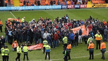 Fans on the Bloomfield Road pitch
