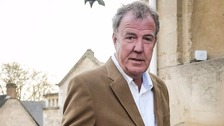 Jeremy Clarkson was seen holding a placard bearing the words 'Pikey's Peak'.