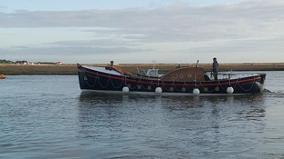 A restored wooden lifeboat, Lucy Lavers, has returned to the sea after standing derelict for 20 years