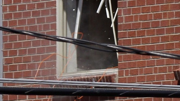 A small amount of smoke is seen at a window of Holmes&#x27; apartment in Aurora
