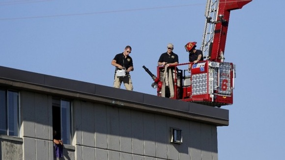 Police on a roof top across from Holmes&#x27; apartment in Colorado