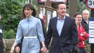 Samantha Cameron and David Cameron arrive at Spelsbury Memorial Hall, Witney, to cast their votes