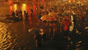 10 people have died after Beijing's worst rainfall in 60 years.