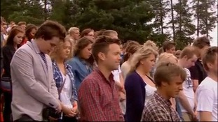 A minute's silence being observed onUtoya island for Breivik's victims.