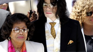 Michael Jackson in 2005 leaving the court with his mother