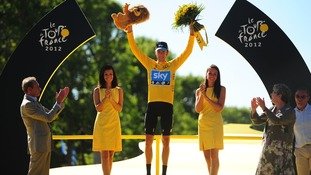 Bradley Wiggins of Sky Pro Racing celebrates on the winners podium after winning the 2012 Tour de France in Paris