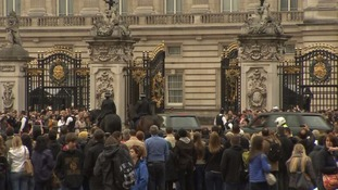 The Queen's convoy arrives at Buckingham Palace