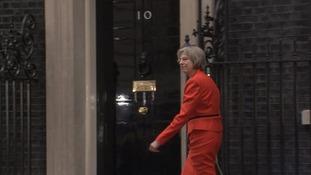Theresa May arrives at Downing Street.