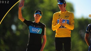 Bradley Wiggins of Sky Pro Racing acknowledges second placed rider and team mate, Chris Froome as they stand on the winners podium