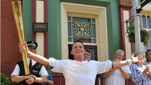 Eastenders character Billy Mitchell played by Perry Fenwick carries the Olympic torch