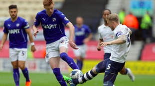 Chesterfield's Sam Clucas challenges for the ball
