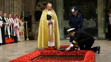 Queen Elizabeth II watches as a wreath is laid at the grave of the Unknown Warrior