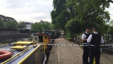 A police cordon has been put up on the towpath of the Grand Union Canal