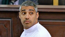 Journalist on trial demands $100m compensation from Al Jazeera.