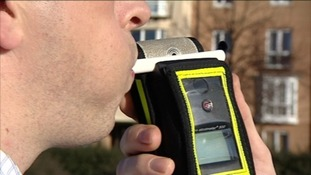 Man blowing in to breathalyser