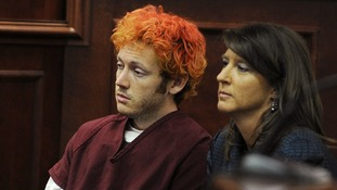 Colorado shooting suspect Holmes sits with public defender