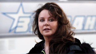British singer Sarah Brightman has postponed her planned trip to the International Space Station