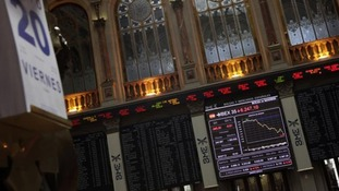n electronic board displays how the benchmark Ibex 35 declined during trading at the Madrid bourse