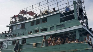 Hundreds of migrants on a boat drifting off the Thai coast