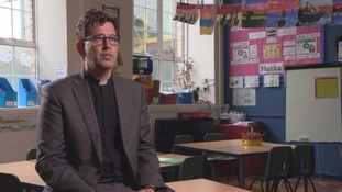 vicar in classroom