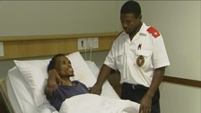 Man in hospital bed in Soweto