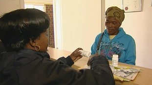 Women picks up prescription drugs from a clinic