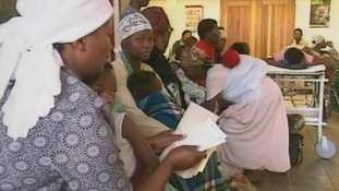 Women wait in a queue in a hospital in Soweto