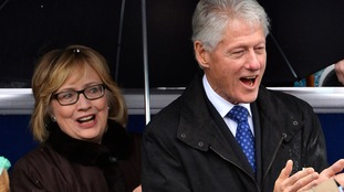 Former U.S. President Bill Clinton (R) and his wife Hillary attend the swearing-in ceremony of Terry McAuliffe as Virginia's governor in Richmond, Virginia.