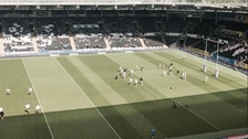 Players warm up before the game at the KC