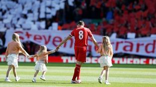 Liverpool captain Steve Gerrard on pitch with his three daughters.