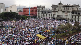 An aerial view shows protesters at a demonstration demanding the resignation of Guatemalan President Otto Perez Molina, in downtown Guatemala City
