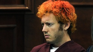 Colorado shooting suspect James Eagan Holmes makes his first court appearance