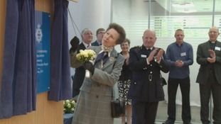 Princess Anne unveils a plaque.