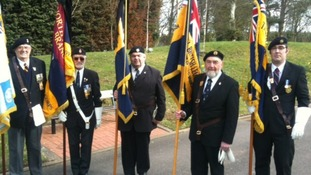 Standard bearers prepare for the funeral of PC David Rathband